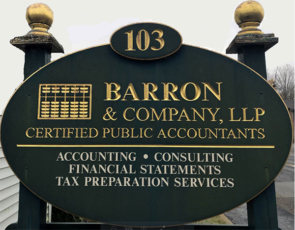 Barron and Company, LLC street sign with green background and gold lettering